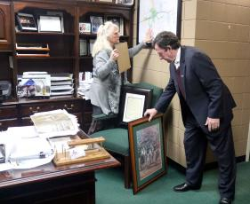 Former Sealy City Manager Lloyd Merrell and his wife Marsha begin taking down pictures and packing up his personal belongings in the city manager's office at city hall on Dec. 14, 2020, after the city council accepted his resignation and placed him on immediate administrative leave with pay. (File Photo)