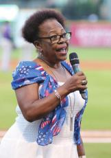 "Former Sealy City Councilwoman Yvonne Johnson sings""God Bless America"" during the seventh inning stretch of the Sealy Day at the Skeeters at Constellation Field in Sugar Land June 30, 2019. FILE PHOTO"