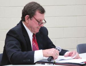 Sealy City Manager Lloyd Merrell reads a statement during a special meeting of the city council on Nov. 30, 2020, in which he asked them to let him do his job or else terminate his employment. File photo