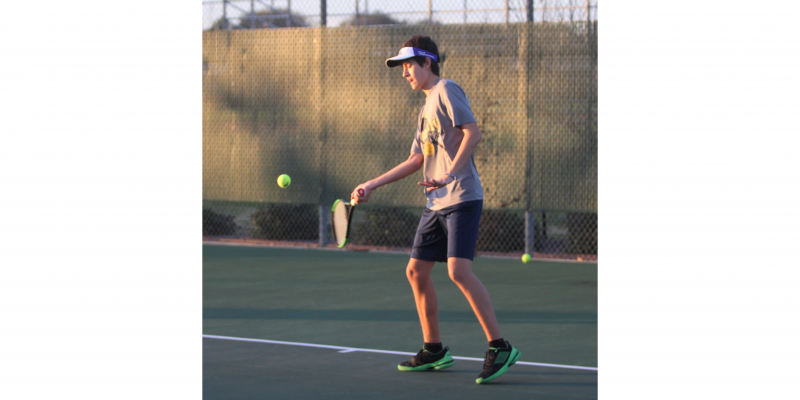 Sealy's Eric Wilson returns a ball during a practice at the tennis courts on March 5, 2020. (Cole McNanna/Sealy News)