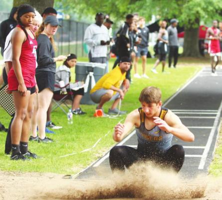 Sealy junior Connor Krenek lands in the sandpit after a jump attempt during the 2019 Area Championship hosted at T.J. Mills Stadium. FILE PHOTOS