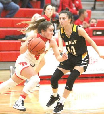 Bellville freshman Mackenzie Watson advances the ball against Sealy senior Heaven Hernandez in the district contest at home on Jan. 8. Cole McNanna