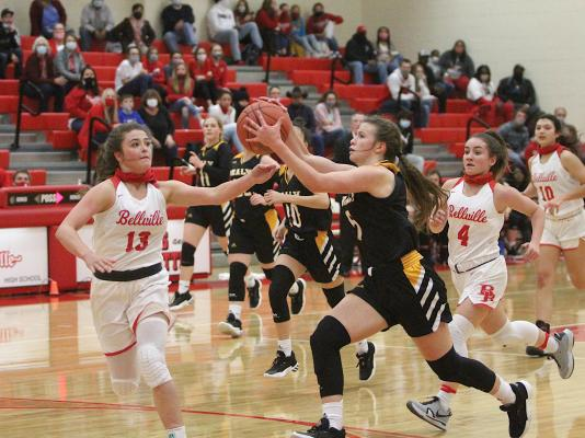 Sealy senior Brylie Bond reaches for a pass in the Lady Tigers' first district game against the Brahmanettes on Jan. 8 at Bellville High School. In the teams' second meeting, Bellville secured the season sweep last week at Sealy High School. (Cole McNanna/Sealy News)