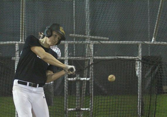 "Sealy senior Rhys Reichardt connects with a pitch at the first official workout of the baseball season last Friday evening at Aubrey ""Mutt"" Stuessel Stadium. (Cole McNanna/Sealy News)"