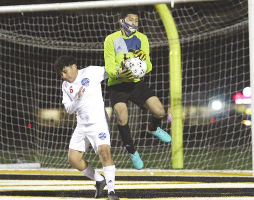 Sealy goalkeeper Brayan Aviles records a save during the Tigers' District 20-4A contest against Houston Harmony School of Discovery last Friday on Mark A. Chapman Field at T.J. Mills Stadium in Sealy. The host Tigers won, 4-0. COLE McNANNA