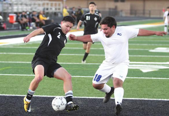 Sealy senior Ricky Avila puts on the breaks to create space between him and a Rice Consolidated defender during the district game at T.J. Mills Stadium Monday evening in Sealy. Avila finished with half of the Tigers' goals in the 8-0 win. COLE McNANNA
