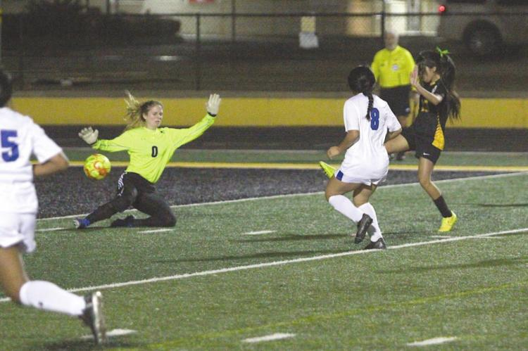 Sealy freshman Rebeca Garza puts home a rebound that gave the Lady Tigers a 3-0 lead in the second half to sweep Rice Consolidated Monday at T.J. Mills Stadium. It was Garza's second goal of the night. COLE McNANNA